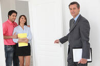 photodune-3762834-couple-viewing-a-property-with-an-estate-agent-s